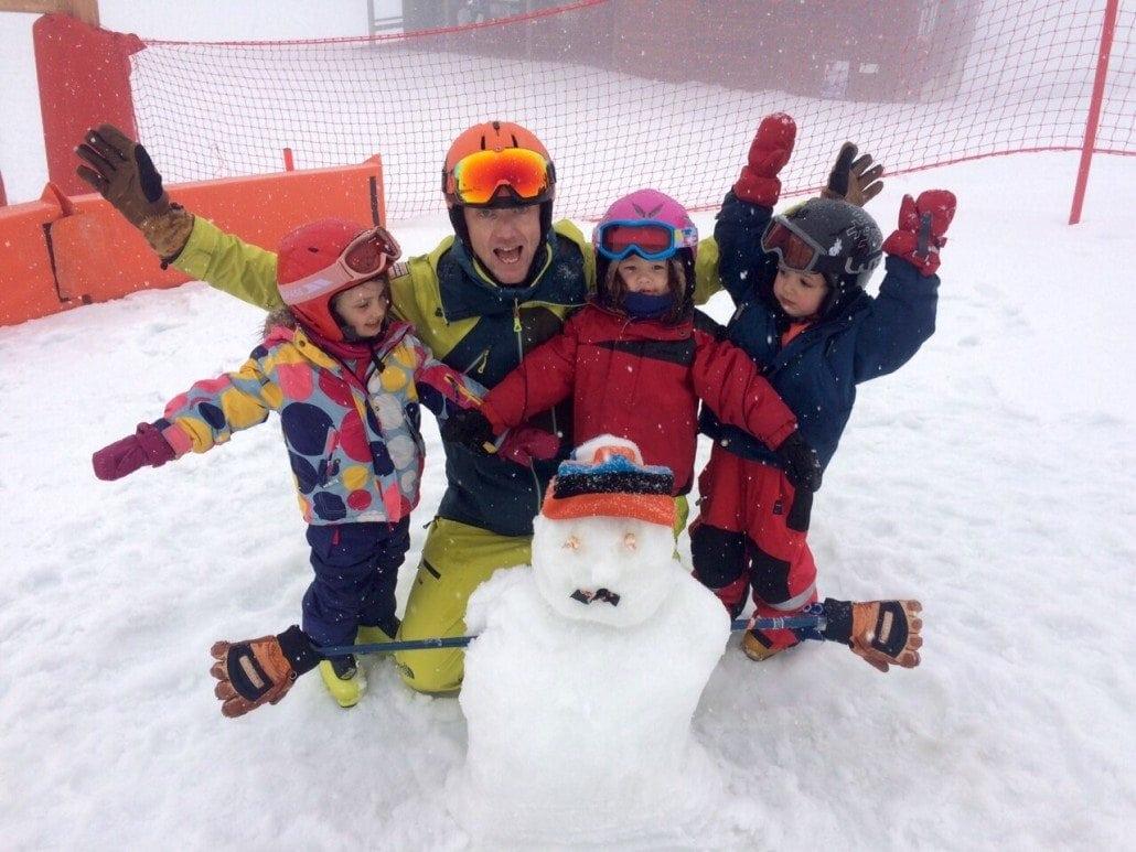 kids ski school snowman