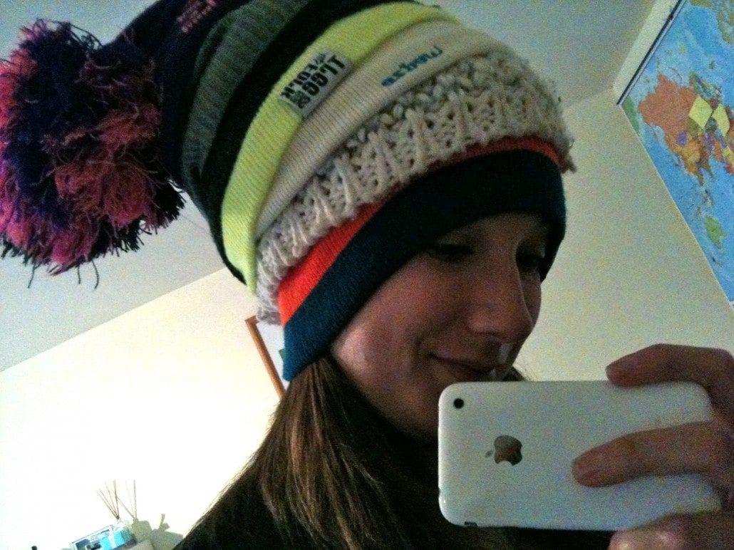 lots of hats ski season packing list
