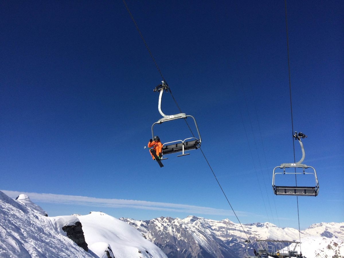 Ski instructor on chairlift in Verbier